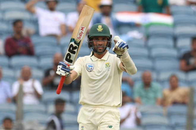 Keshav Maharaj of South Africa celebrates his fifty during day 3 of the second test match between India and South Africa held at the Maharashtra Cricket Association Stadium in Pune, India on the 12th October 2019