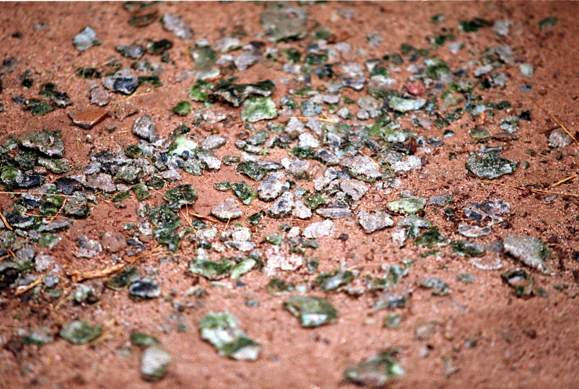 Trinitite, the green, glassy substance at The Trinity Site, scattered at ground zero.