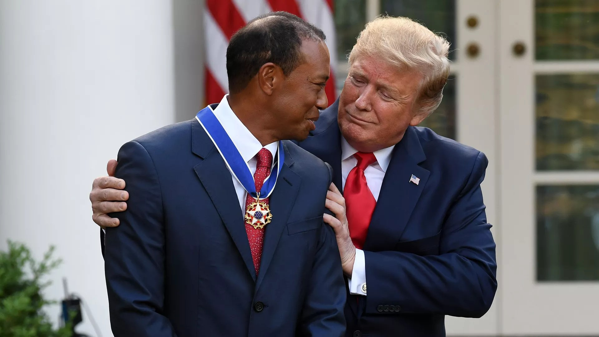 President Donald Trump presents US golfer Tiger Woods with the Presidential Medal of Freedom during a ceremony in the Rose Garden of the White House in Washington, DC, Monday.