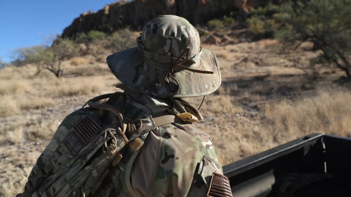 A civilian paramilitary with Arizona Border Recon watches for drug smugglers and undocumented immigrants crossing the U.S.-Mexico border near Arivaca, Arizona. Photo: John Moore/Getty Images