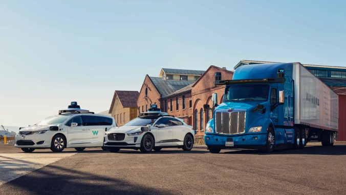 Image of 2 self-driving Waymo cars and a self-driving semi-truck.