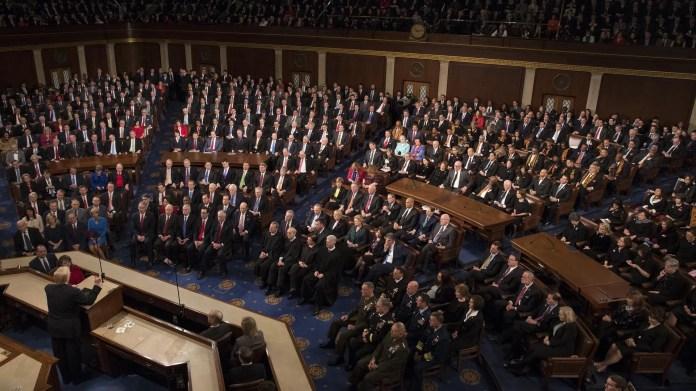 An aerial shot of Trump standing before Congress