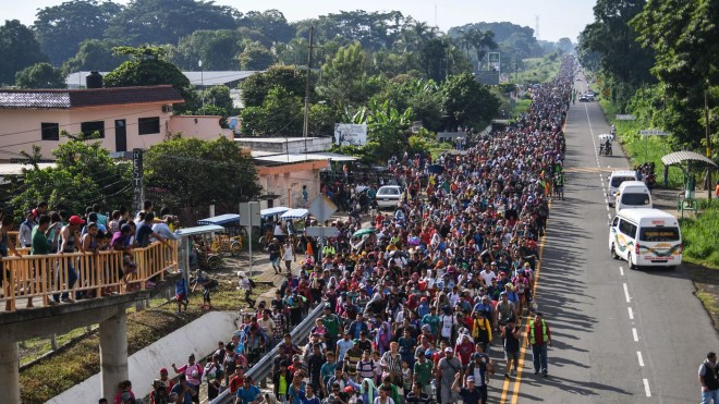 The caravan of Central American migrants regrouped and heading to the U.S. from the southern Mexican city of Ciudad Hidalgo. Photo: Pedro Pardo/AFP/Getty Images