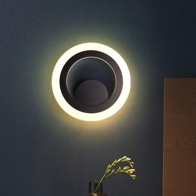 led great room wall lighting ideas modern black wall sconce with circular metal shade in warm white light