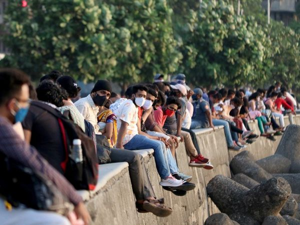 This picture is of Marine Drive in Mumbai.  People are gathering at public places in such a way to save the rent of the house.