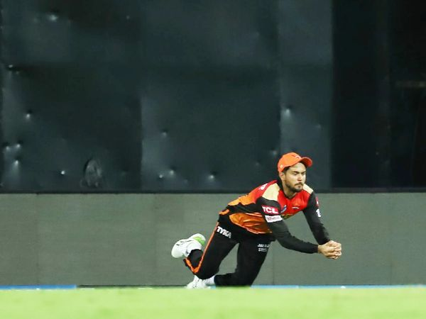 Manish Pandey of SRH taking a catch by diving on the boundary.  He caught Sundar's brilliant catch on Rashid's ball.