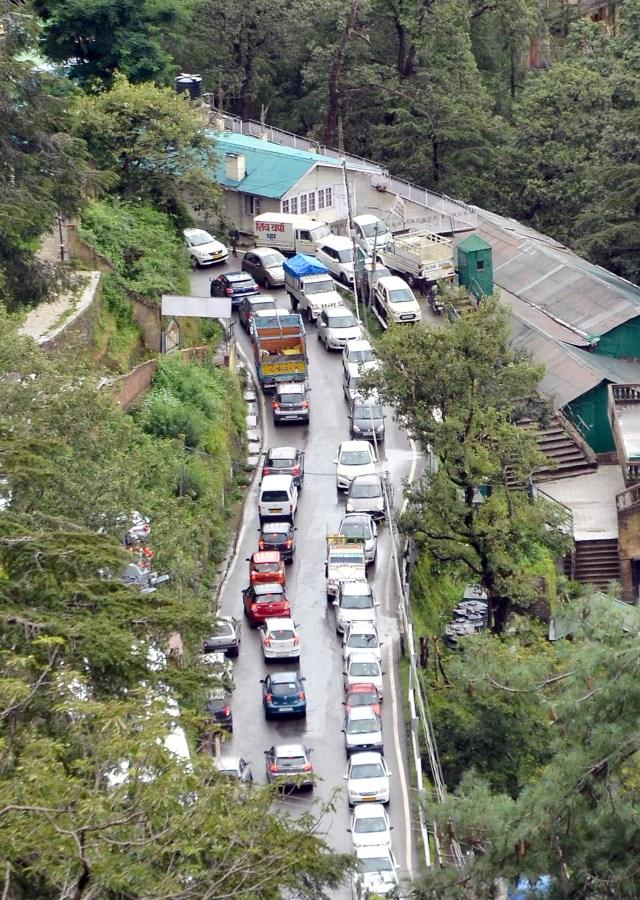 Vehicles stuck in a jam after heavy rains at Lakkar Bazar in Shimla on Monday.