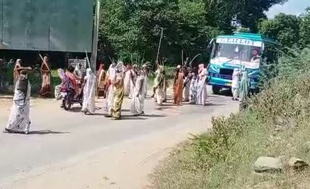 A women's group threatening to rob the bus driver who came out as per tradition.