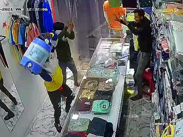 The incident was caught on camera installed inside the shop.