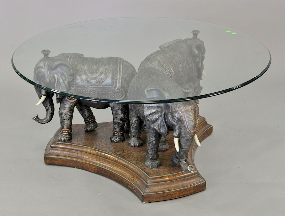 coffee table with triple elephant base and glass top ht 20 in dia 44 in