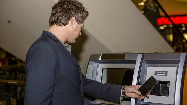 ABA Technology director Robert Masters uses the ATM. Photo by: Jamila Toderas