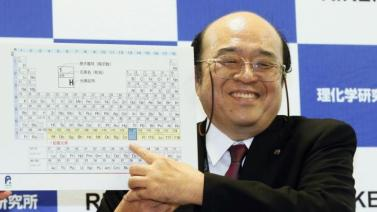 Kosuke Morita of Riken Nishina Center for Accelerator-Based Science points at periodic table of the elements during a press conference in Wako, Saitama prefecture, near Tokyo Thursday, Dec. 31, 2015. A team of Japanese scientists have met the criteria for naming a new element, the synthetic highly radioactive element 113, more than a dozen years after they began working to create it. Morita was notified of the decision on Thursday by the U.S.-based International Union of Pure and Applied Chemistry. (Kyodo News via AP) JAPAN OUT, MANDATORY CREDIT