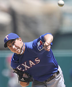 The Rangers look wise keeping rookie Derek Holland instead of trading him in a package for Roy Halladay. (AP)