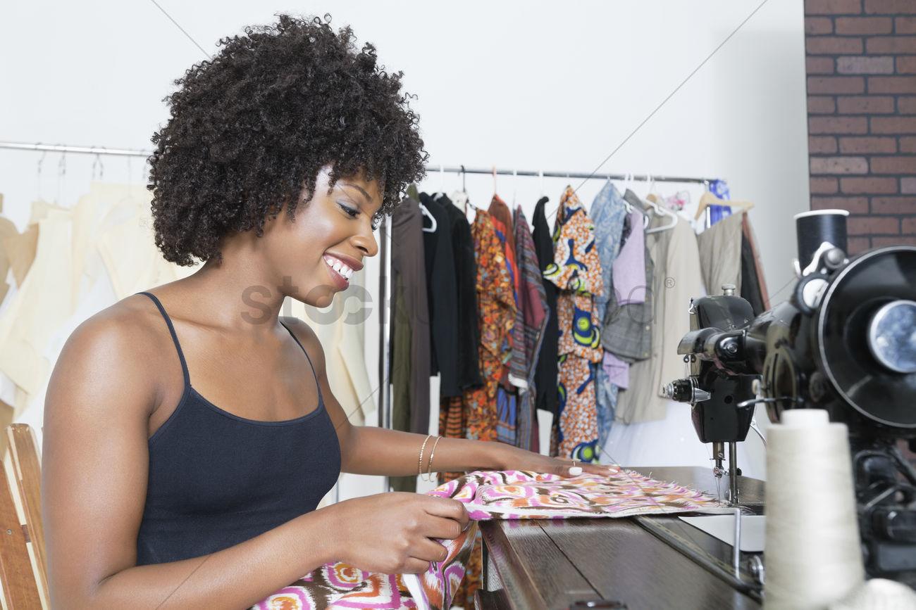 African American Female Dressmaker Stitching Cloth On