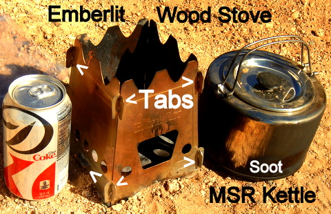 The Emberlit has tabs that hold it together. Just unsnap them and it will lay down flat in a quart Ziploc bag. You can see the clean spot I made on the MSR Kettle. Soot is just a fact of life with wood cook stoves.