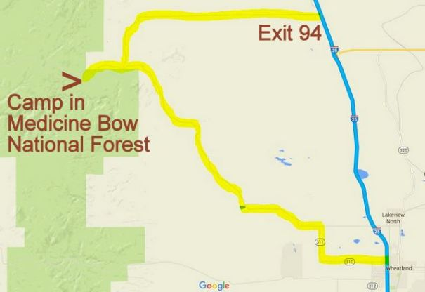 The problem with finding National Forests along the Interstates is finding an Exit close to them that also gives access to them. By carrying a Benchmark or DeLorme Atlas, they both show the major Forest Roads and the Exits so you can know where to gt off the freeway and into them. They both give enough details that I had no problem finding my way into the Forest and a great campsite. On the way out I did it as a loop and got gas in Wheatland, WY.