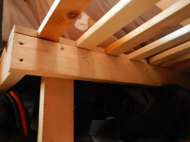 Looking up at the bottom of the bed. The two sides of the bed share the center set of legs as support.