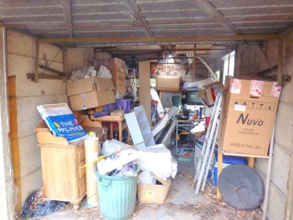 An overflowing garage is hoarding on a much smaller scale and the majority of us suffer from it--even vandwellers. Image taken from http://juliefountain.blogspot.com/2011_03_01_archive.html