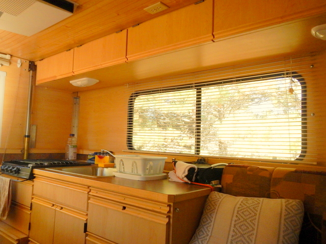 Inside  it a all beautiful woodwork and very open  Because it goes up. Living or Traveling in an Alaskan Camper   Cheap RV Living com