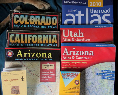 Here we see me my most important tools: Benchmark Atlas, Delorme Atlas, BLM or NF maps, and a Walm-Mart Atlas. One of my goals is to be as close as possible to a Wal-Mart for cheap shopping. You can buy these Atlas' from Wal-Mart and they list every store in every state. I always check out how far I am from the nearest Wal-Mart.