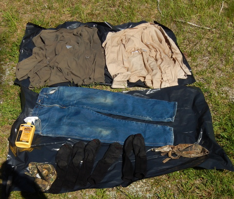 I laid out some trash bags to do it on. After the clothes are treated : permethrin tent - memphite.com