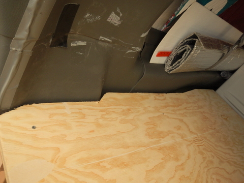 Here you can see how we had to cut the plywood around the elaborate plastic on the walls of the Chevy Express. It wasted so much we couldn't sleep side-to-side.