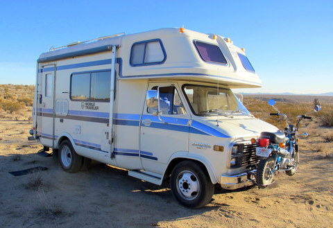 This is a mid-80s 18 foot Mobile Traveler Class C. It is one of the bet rigs I have ever seen in person! He gets 10 mpg and carries a Honda Trail 50 on the front bumper that gets 100 mpg. The shorty, Mobile Travelers are in high demand so it was not cheap.