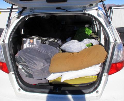 Looking in back hatch of my friends car.