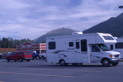 This Class C RV stands out in a Wal-Mart parking lot. When you see it parked overnight, your first thought is someone might be sleeping in it. To the left of the RV is a red van. Other than the color, it blends in well and you wouldn't even notice it.