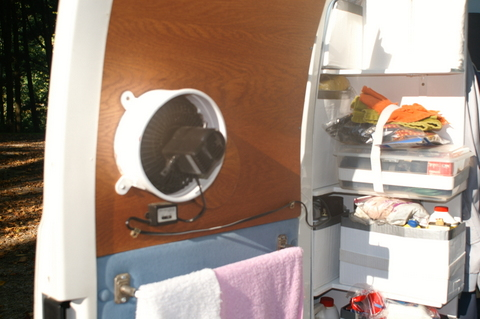 Wanting more ventilation, he mounted a fan in one of the back doors. The window opens outward for when he turns it on.