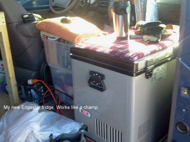 To save every inch of space, he took out his passenger seat and put a 12 volt fridge in it's place.