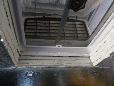Looking up the vent and cover. Notice also four layers of 3/4 inch Styrofoam insulation.