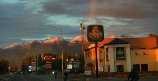 At the same time I took the shot above of the suset I took this one of the rainbow. Remember, it's 11:00 pm at night! Notice the two guys going by on their bikes and another guy walking; also lots of traffic on the rod. Time means nothing to Alaskans in the summer!