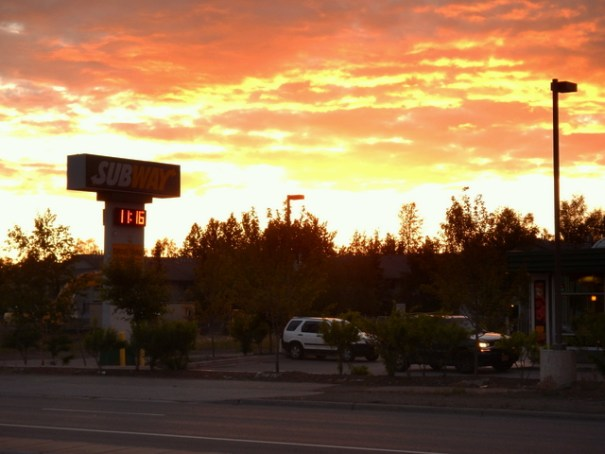 I took this sunset picture in Anchorage on June 9th. In the sign you can see the time is 11:15 pm and the sun has just gone below the horizon. Right now, the sun is setting at 11:40 pm at night.
