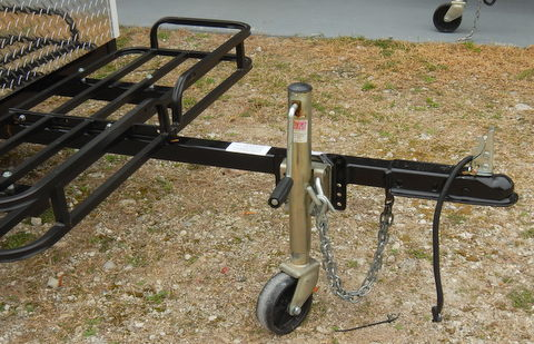 The jack swings away if you are in rough terrain. Notice e front cargo rack that gives you lots of outside storage.