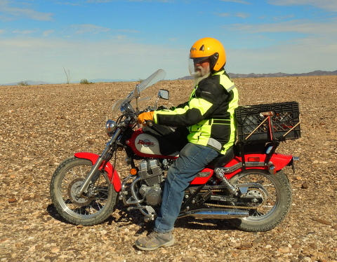 Riding a motorcycle is much faster  and more comfortable than a bicycle or scooter. But they are also more dangerous. Being seen is critical to safety so I have a red motorcycle, yellow helmet, and a bright green coat. I'm hard to miss!!