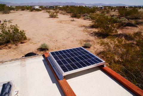 Here is the panel mounted on the roof of my home-built camper at the Slabs.