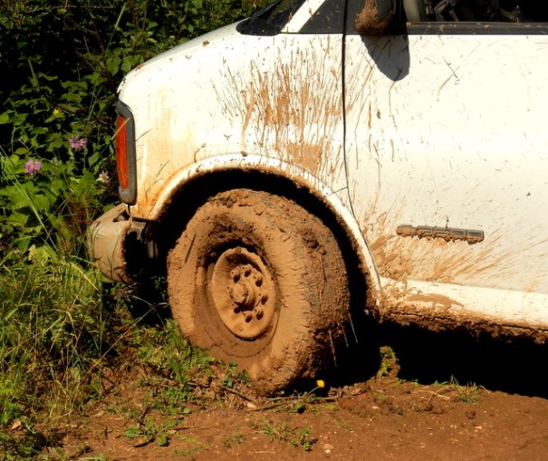 The right side of the van was in the deepest mud and without a locking rear-end when those tires broke lose and spun I was done for.
