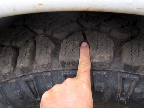 These are Goodyear Wrangler Mud tires. You can see they have very deep and wide treads. But just as important are the lugs on the sidewalls.
