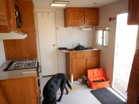 Looking forward at the living area. It has all the comfort of home and nothing extra refrigerator, oven/stove, sink and counter-top, cabinets.
