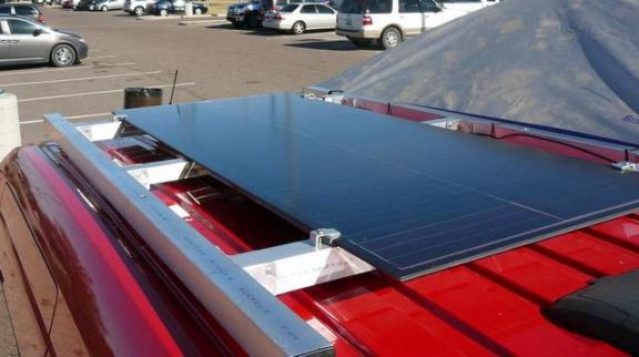 The used solar panel he bought mounted on 2x2 tubing.