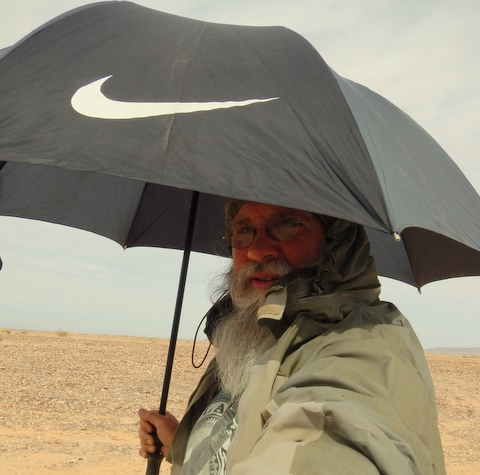 These two items are essential whenever storms blow in: 1) a quality waterprrof-breathable rain jacket like this Outdoor Research 2) a quality umbrella like this Nike.