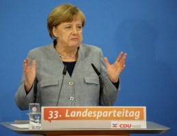 Los socialdemócratas alemanes deciden hoy una eventual alianza con Angela Merkel