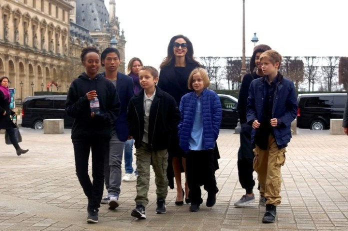 Angelina Jolie and their six children in Paris: Zahara, Madox, Knox, Vivienne, Pax, and Shiloh, now John.