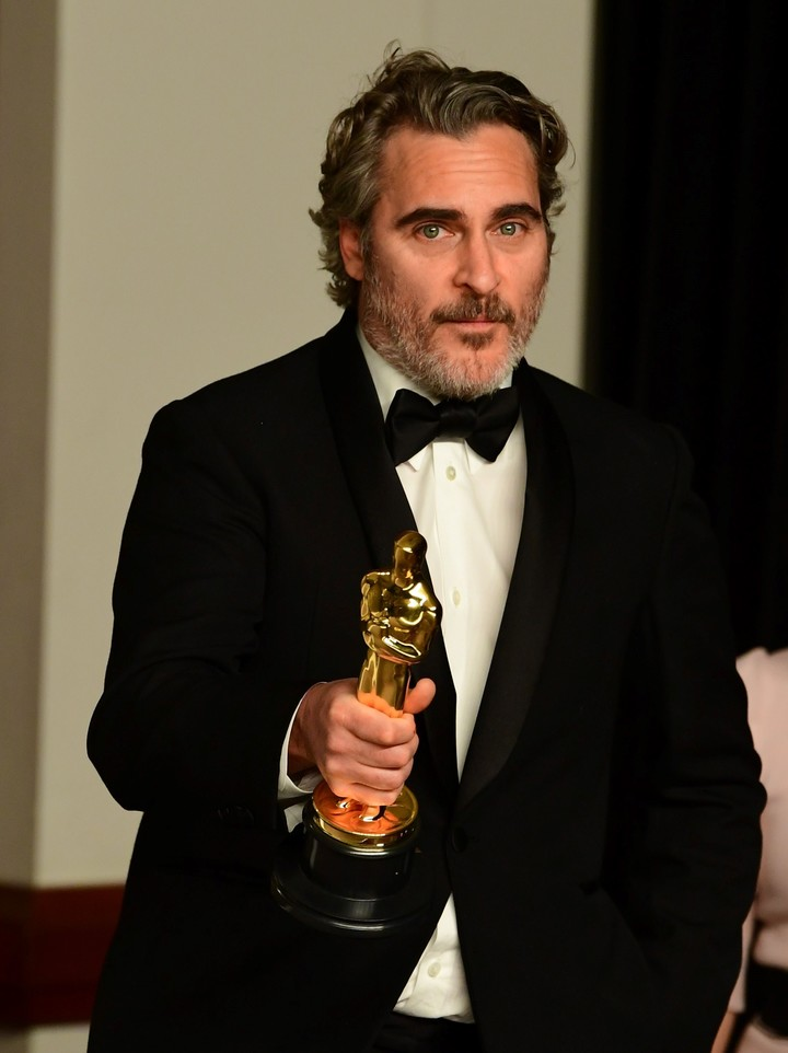 Joaquin Phoenix, mejor actor. (Photo by FREDERIC J. BROWN / AFP)