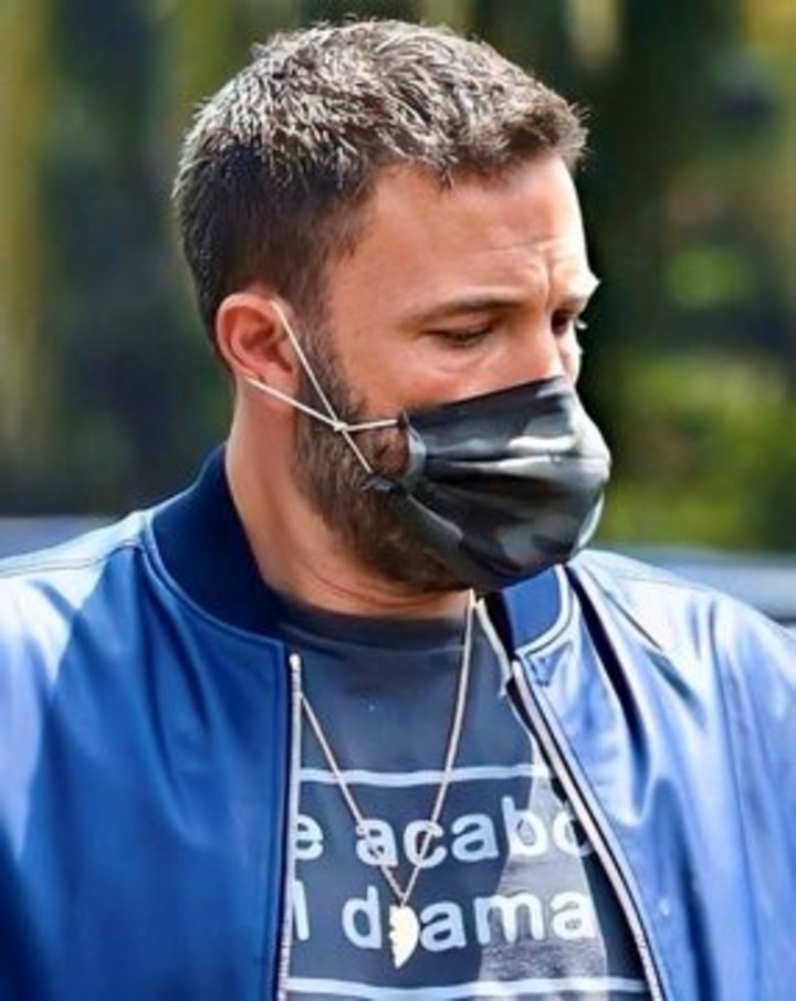 Ben Affleck, taking care of the covid with his chinstrap.