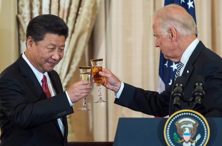 Xi Jinping with Joe Biden in 2015. AFP Photo