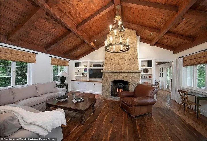 The living room, with warm interior spaces and a fireplace.