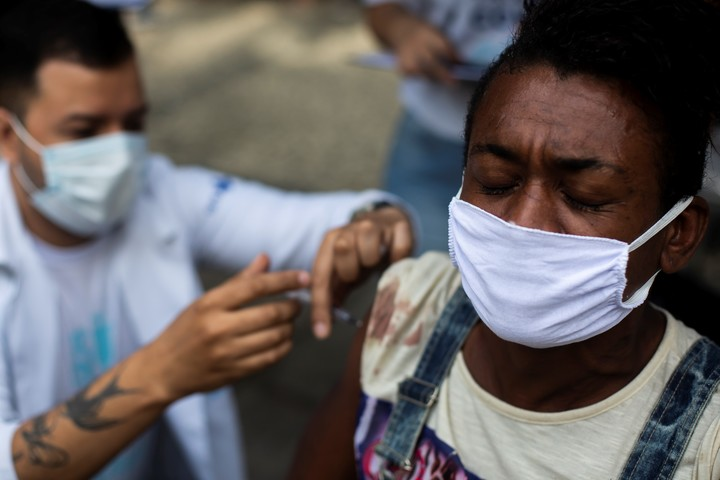A woman receives a dose of the coronavirus vaccine during a vaccination campaign for people living on the street in Rio de Janeiro.  Photo: AP