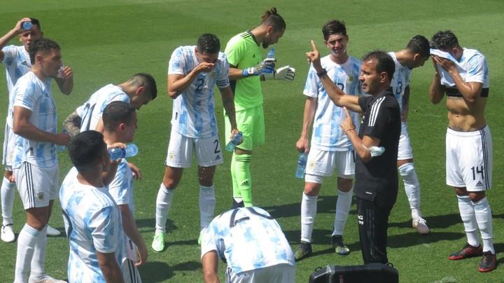 Bocha Batista gives directions at halftime.